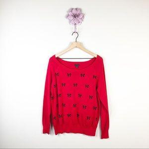 Torrid Red / Black Bow Print Scoop Neck Sweater